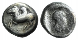 Corinth, c. 500-480 BC. AR Stater (17mm, 8.33g, 10h). Pegasos flying l. R/ Helmeted head of Athena right within incuse square. Pegasi 68; BCD Corinth ...