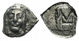 Ionia, Kolophon, c. 450-410. AR Hemiobol (7mm, 0.32g, 12h). Facing head of Apollo. R/ Monogram (mark of value) within incuse rectangle. Milne, Colopho...