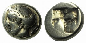 Ionia, Phokaia, c. 478-387 BC. EL Hekte – Sixth Stater (9mm, 2.50g). Female head l., hair bound in sakkos; seal to r. R/ Quadripartite incuse square. ...