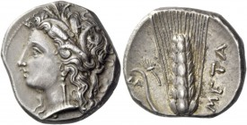 Metapontum. Nomos circa 330-290, AR 7.89 g. Head of Demeter l., wearing earring and barley wreath. Rev. META Ear of barley, with leaf to l. which pass...
