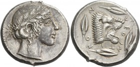 Leontini. Tetradrachm circa 450, AR 17.62 g. Laureate head of Apollo r. Rev. LEO – NTI – NO – N Lion's head r., with jaws open and tongue protruding; ...