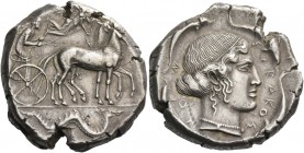 Syracuse. Tetradrachm circa 460-440, AR 17.44 g. Slow quadriga driven r. by charioteer, holding reins and kentron; above, Nike flying r. to crown the ...