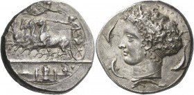 Syracuse. Decadrachm signed by Kimon circa 404-400, AR 43.33 g. Fast quadriga driven l. by charioteer, holding reins and kentron; in field above, Nike...