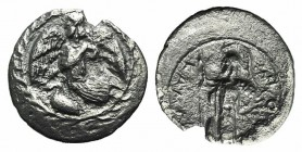Sicily, Kamarina, c. 461-440/35 BC. AR Litra (11mm, 0.47g, 5h). Nike flying l.; below, swan standing l.; all within wreath. R/ Athena standing l., hol...