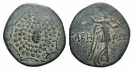 Pontos, Kabeira, c. 120-100 BC. Æ (21mm, 6.13g, 12h). Three-quarter facing head of gorgoneion, head turned slightly r., on an aegis. R/ Nike walking r...
