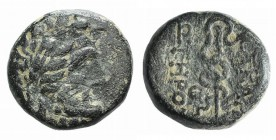 Mysia, Pergamon, c. 133-27 BC. Æ (11mm, 2.52g, 12h). Laureate head of Asklepios r. R/ Serpent-entwined staff of Asklepios. SNG BnF 1828-48. Green pati...