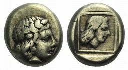 Lesbos, Mytilene, c. 412-378 BC. EL Hekte – Sixth Stater (9mm, 2.49g, 6h). Laureate head of Apollo r. R/ Head of female r. in linear square within inc...