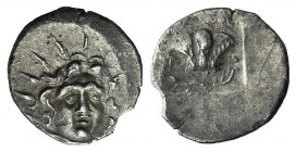 Islands of Caria, Rhodos, Rhodes, c. 125-88 BC. AR Hemidrachm (12mm, 1.43g, 11h). Uncertain magistrate. Radiate head of Helios facing slightly r. R/ R...