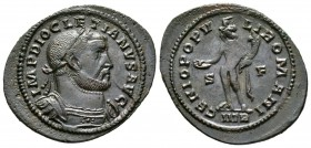 Diocletian (284-305), Follis, Treveri, c. 302-3, 6.63g, 33mm. Laureate and cuirassed bust right / Genius standing left, holding patera and cornucopia;...