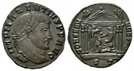Maxentius (307-312), Follis, Ticinum, 308-310, 5.28g, 25mm. Laureate head right / Tetrastyle temple, containing Roma seated left on throne, holding gl...