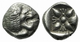 Ionia, Miletos, late 6th-early 5th century BC. AR Diobol (8mm, 1.12g). Forepart of a lion l., head r. R/ Stellate design within square incuse. SNG Kay...