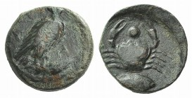 Sicily, Akragas, c. 425-406 BC. Æ Onkia (16mm, 3.96g, 4h). Eagle standing r. with head reverted, on a fish. R/ Crab, fish l. below; pellet between cra...