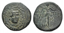 Paphlagonia, Sinope c. 85-65 BC. Æ (20mm, 7.37g, 12h). Head of Medusa facing slightly r. R/ Nike, wearing chiton, advancing r., holding palm across he...