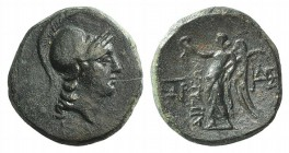 Aeolis, Aigai, 2nd-1st centuries BC. Æ (16mm, 4.08g, 12h). Helmeted head of Athena r. R/ Nike advancing l., holding wreath and palm; monograms to l. a...