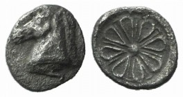 Aeolis, Kyme, c. 6th century BC. AR Hemiobol (5mm, 0.18g). Head of horse l. R/ Stellate floral pattern. Unpublished in the standard references. Rare, ...