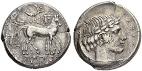 SICILY. Catane. Tetradrachm c. 450. Obv. Slow quadriga to r., the driver, wearing long chiton, holding the reins with his r. hand, the kentron with hi...