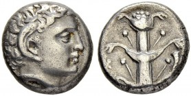 CYRENAICA. Cyrene. Didrachm 3rd century. Obv. Head of young Apollo Carneios with ram's horn to r. Rev. Silphium plant. Cornucopia on r. 7.56 g. BMC 23...