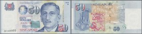 Singapore: 50 Dollars ND(1999), P.41 with fancy serial number 0BT999999 in excellent condition without any fold, but a few brownish spots at upper mar...