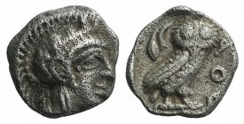 Attica, Athens, c. 454-404 BC. AR Obol (8.5mm, 0.66g, 3h). Helmeted head of Athena r. R/ Owl standing r., head facing; olive sprig and crescent behind...