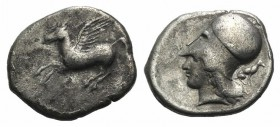 Corinth, c. 400-375 BC. AR Stater (23mm, 8.22g, 7h). Pegasos flying l. R/ Helmeted head of Athena l.; behind, hound seated r. Pegasi 135; BCD Corinth ...