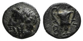 Cyclades, Syros, 3rd-1st centuries BC. Æ (10mm, 1.22g, 12h). Wreathed head of Dionysos l. R/ Kantharos. SNG Copenhagen -; cf. Laffaille 134 (symbols)....