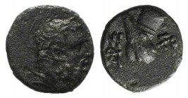 Pontos, Amisos, time of Mithradates VI, c. 85-65 BC. Æ (10mm, 1.15g, 1h). Laureate head of Herakles r. R/ Club and quiver crossed; monogram to lower l...