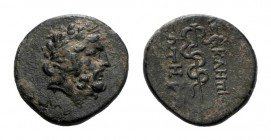 Mysia, Pergamon, c. 133-27 BC. Æ (17mm, 3.40g, 12h). Laureate head of Asklepios r. R/ Serpent-entwined staff of Asklepios. SNG BnF 1828-48. Green pati...