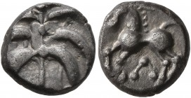 CELTIC, Central Europe. Helvetii. Mid 1st century BC. Quinarius (Silver, 11 mm, 1.74 g), 'Büschelquinar'. Palmette made from six curved leaves connect...