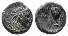 Aeolis, Myrina. ca.2nd-1st centuries BC. Æ (11mm, 1.79g). Radiate head of Helios right within dotted border. / MY - PI, ethnic across field divided by...