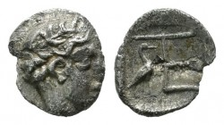 Ionia, Kolophon. ca.450-410 BC. AR Tetartemorion (6mm, 0.25g). Laureate head of Apollo right. / TE monogram, stork standing right, at left, all within...