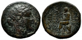 Ionia, Smyrna. Circa 125-115 BC. Æ 20mm (21mm, 8.27g). Phanokrates, magistrate. Laureate head of Apollo right / The poet Homer seated left, holding sc...