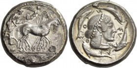 Syracuse. Tetradrachm circa 466-460, AR 17.12 g. Charioteer, holding kentron in r. hand and reins in l., driving slow quadriga r.; above, Nike flying ...