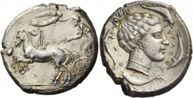Syracuse. Tetradrachm circa 440-430, AR 17.27 g. Prancing quadriga driven l. by charioteer, holding kentron and reins; above, Nike flying r. to crown ...