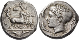 Syracuse. Tetradrachm signed by Eumenes and Euainetos circa 410, AR 17.39 g. Fast quadriga driven r. by charioteer holding reins and kentron. Above, N...