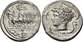 Syracuse. Tetradrachm signed by Euth and Eumenes circa 405, AR 17.18 g. Fast quadriga driven r. by winged young god, holding reins with both hands; ab...