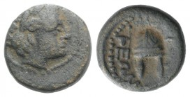 Macedon, Orthagoreia, c. 350 BC. Æ (12mm, 2.50g, 9h). Laureate head of Apollo r. R/ Macedonian helmet surmounted by a star. SNG ANS 566-70. About VF