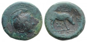Macedon, Pella, c. 187-168/7 BC. Æ (17mm, 5.04g, 12h). Helmeted head of Athena r. R/ Cow grazing r. SNG ANS 606. Dark green patina, near VF