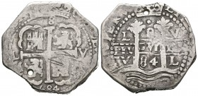 Carlos II (1665-1700). 8 reales. 1684. Lima. V. (Cal-227). Ag. 29,21 g. Dos fechas visibles. Agujero. MBC/MBC+. Est...140,00.