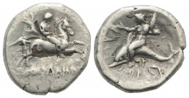 Southern Apulia, Tarentum, c. 280 BC. Fourrèe Nomos (23mm, 7.28g, 3h). Nikodamos, magistrate. Youth on horse galloping r. R/ Phalanthos, holding kanth...