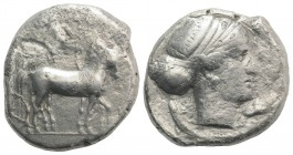 Sicily, Syracuse, 466-405 BC. AR Tetradrachm (26mm, 16.84g, 1h), c. 430 BC. Charioteer driving quadriga r.; above, Nike flying r., crowning horses. R/...