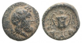 Islands of Thessaly, Peparethos, 4th-3rd centuries BC. Æ Chalkous (12mm, 1.99g, 9h). Bearded head of Dionysos r., wearing ivy wreath. R/ Π-Ε, Kantharo...