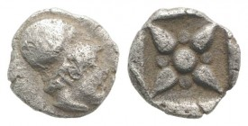 Asia Minor, Uncertain mint, 5th century BC. AR Hemiobol (6mm, 0.41g). Helmeted head of Athena r. R/ Star of four rays; pellets between rays; all withi...