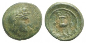 Bithynia, Kios, c. 3rd century BC. Æ (11.5mm, 1.47g, 12h). Head of Mithras r., wearing a laureate tiara. R/ Kantharos with two grape vines within wrea...