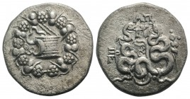 Mysia, Pergamon, c. 166-67 BC. AR Cistophoric Tetradrachm (27mm, 11.94g, 12h), c. 76 BC. Cista mystica with serpent; all within ivy-wreath. R/ Two ser...