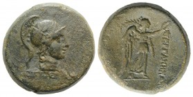 Mysia, Pergamon, c. 133-27 BC. Æ (22mm, 12.39g, 12h). Pergamos, magistrate. Helmeted head of Athena r. R/ Nike standing r., holding wreath and palm. S...
