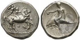 Apulia, Tarentum, Nomos, ca. 340-332 BC; AR (g 7,90; mm 21; h 12); Horseman galloping r., crowned by Nike; horse restrained at neck by groom; below, I...