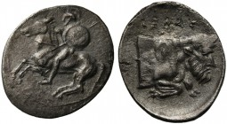 Sicily, Gela, Litra, ca. 430-425 BC; AR (g 0,69; mm 13; h 12); Warrior riding horse l., holding shield and spear, Rv. ΓΕΛΑΣ, forepart of man-headed bu...