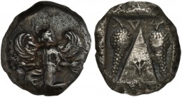 Caria, Kaunos, Stater, ca. 430-410 BC; AR (g 11,08; mm 22; h 12); Winged female figure in kneeling-running stance l., head right, holding kerykeion an...