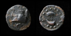 MEGARIS, Megara, 350-275 BCE, Æ15 (dichalkon?). 1.77g, 15mm. Obv: Prow of galley left on which stands a tripod. Rev: MEΓ, two dolphins swimming counte...