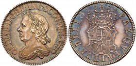 Oliver Cromwell (d.1658). Silver Shilling, 1658, laureate and draped bust left, raised die flaw at top of forehead, legend and toothed border surround...